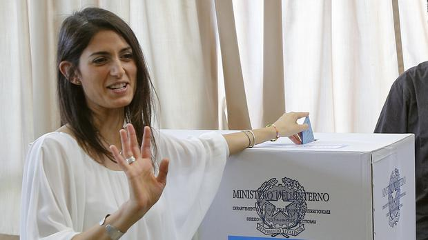 Virginia Raggi casts her ballot in a polling station in Rome (AP)
