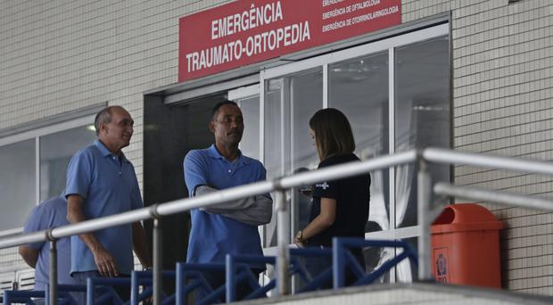 Employees stand in front an emergency entrance at Souza Aguiar Hospital in Rio de Janeiro (AP)