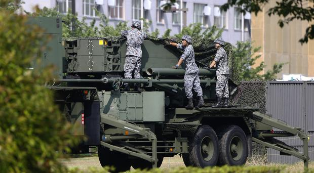 Japan Self-Defence Force members set up a PAC-3 Patriot missile unit deployed in case of a North Korean rocket launch (AP)
