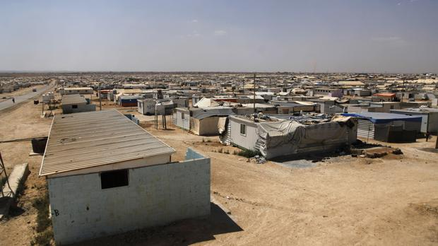 Some 64,000 Syrians live in two encampments along the Jordanian border (AP)