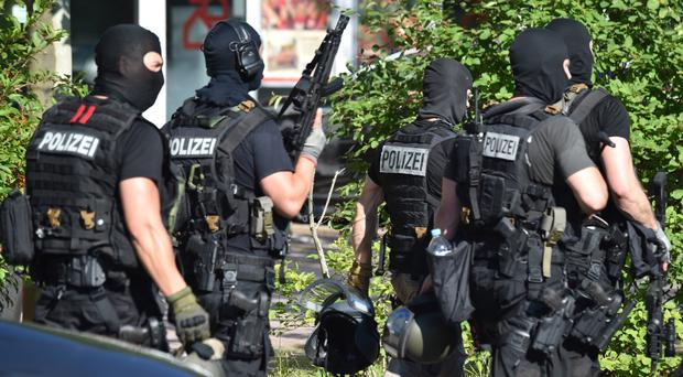 Police officers stand near a cinema in Viernheim near Mannheim, southern Germany (AP)