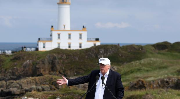 US presidential hopeful Donald Trump gives a speech at his revamped Trump Turnberry golf course in South Ayrshire