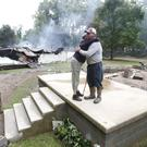 Residents begin the clean up of what remains of their property in West Virginia following severe flooding (AP)