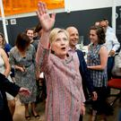 Hillary Clinton waves to workers while visiting Galvanize, a work space for technology companies, in Denver, Colorado (AP)