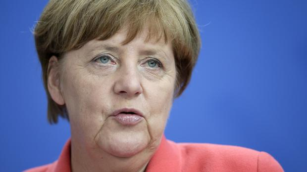 German Chancellor Angela Merkel has held her last ever meeting at a Brussels summit with David Cameron (AP)