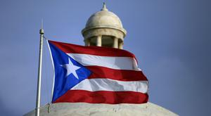 Puerto Rico is in a decade-long recession and is 70 billion dollars in debt (AP)