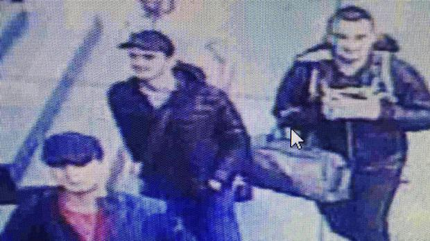 The people believed to be the attackers walk in Istanbul's Ataturk airport (Haberturk newspaper via AP)