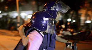 A security member is taken for medical treatment after the attack on a restaurant popular with foreigners in a diplomatic zone of the Bangladeshi capital Dhaka (AP)