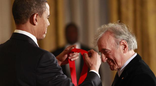 Elie Wiesel, right, is presented with the 2009 National Humanities Medal by US president Barack Obama (AP)