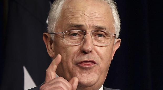Australia's prime minister Malcolm Turnbull is seeking the support of minority MPs (AP)