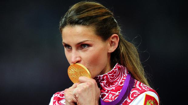 Russian high jump champion Anna Chicherova celebrates winning gold at the London 2012 Olympics