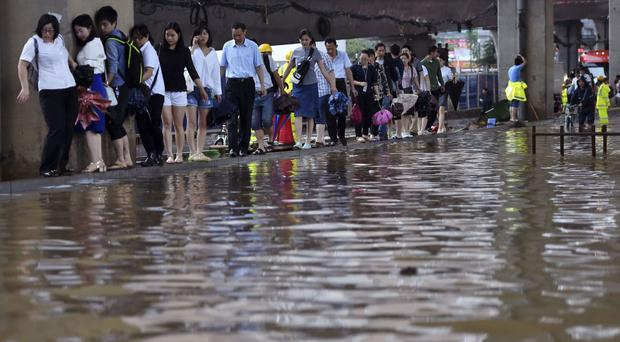 A flooded road in Wuhan in central China's Hubei province, where water levels are starting to recede following a week of heavy downpours (Chinatopix/AP)