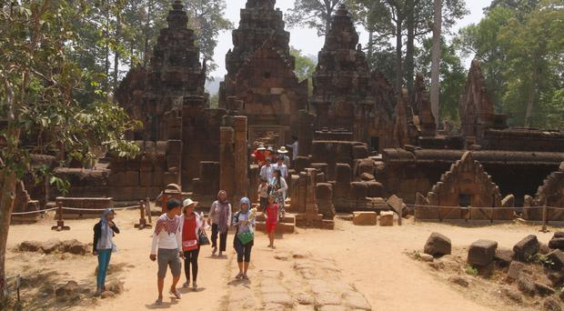Tourists at the Banteay Srey temple in the Angkor complex (AP)