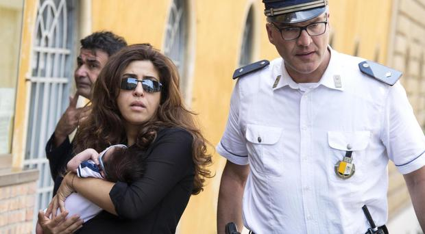 Public relations expert Francesca Chaouqui arrives with her newly-born son Pietro, at the Vatican for her trial (AP)