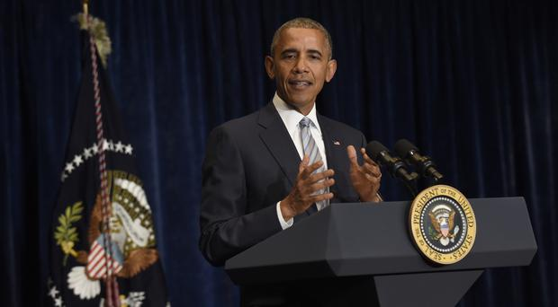 President Barack Obama makes a statement on the fatal police shootings of two black men in Louisiana and Minnesota after arriving in Warsaw (AP)