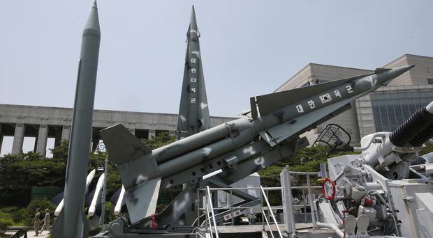 South Korea's mock missiles are displayed next to North Korea's mock Scud-B, left, in Seoul (AP)