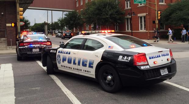 Police shut down the street in front of Dallas Police headquarters with the city on edge following the shooting of five officers (AP)