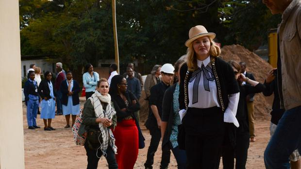 Madonna visits the paediatric surgery and Malawi's first ever intensive care unit at Queen Elizabeth Central Hospital in Blantyre (AP)