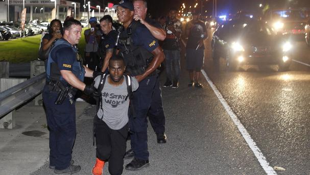 Police arrest activist DeRay McKesson during a protest in Baton Rouge (AP)