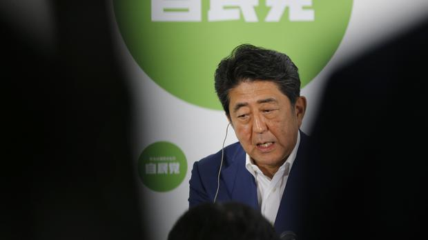 Japan's Prime Minister Shinzo Abe promised new government spending to help move the economy out of the doldrums (AP)