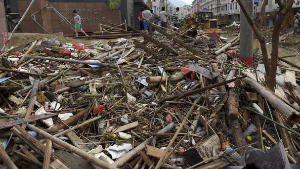 A street covered with debris in Minqing county after Typhoon Nepartak hit (Xinhua/AP)