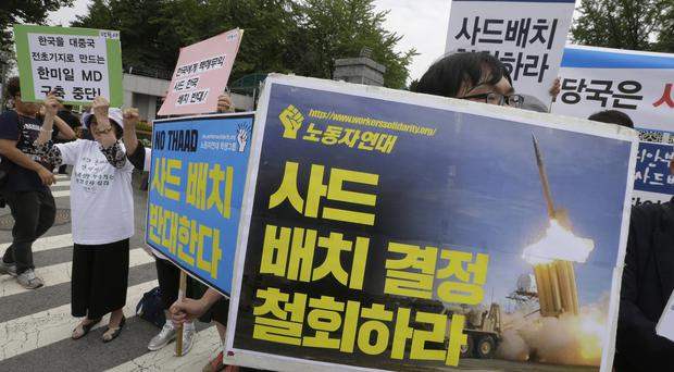 Protesters stage a rally in front of the Defence Ministry in Seoul to denounce deployment of the US's Terminal High-Altitude Area Defence (THAAD) system (AP)