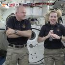Astronaut Kate Rubins, pictured with Expedition 48 commander Jeff Williams aboard the International Space Station, will attempt to complete the first full-blown DNA sequencing in orbit (Nasa/AP)
