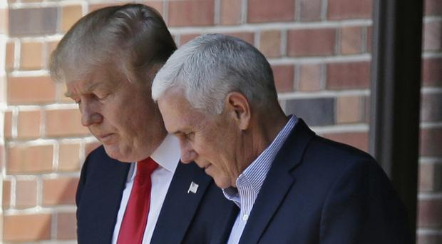 Donald Trump, pictured left with Mike Pence, leaves the Indiana governor's home in Indianapolis (AP)