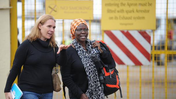 Aid workers based in South Sudan arrive in Kenya after their evacuation (AP)