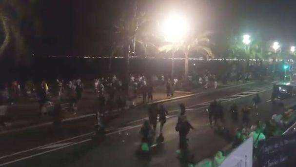 People running away after dozens of people are believed to have been killed in Nice (@harp_detectives)