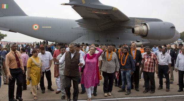 Indians evacuated from South Sudan arrive at Palam airport (AP)