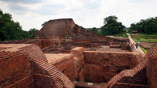 Tourists walk in the ruins of the Nalanda University in India (AP)