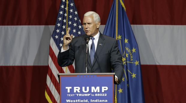 Indiana governor Mike Pence is Donald Trump's running mate (AP)