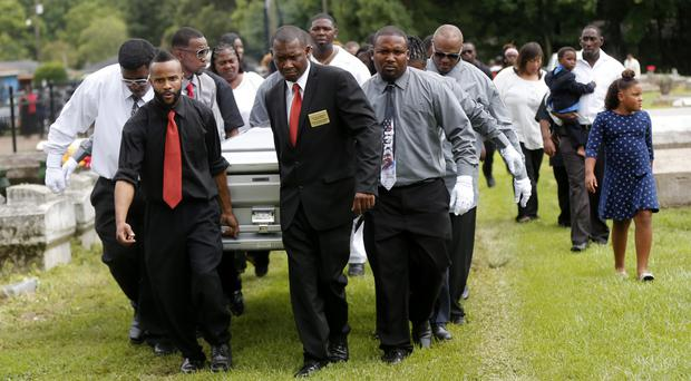 Pall bearers carry the coffin of Alton Sterling to his grave at the Mount Pilgrim Benevolent Society Cemetery in Baton Rouge (AP)
