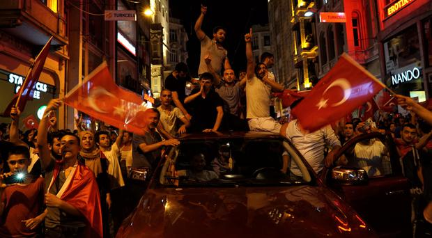 People chant slogans during a pro-government rally in Istanbul's Taksim Square (AP)