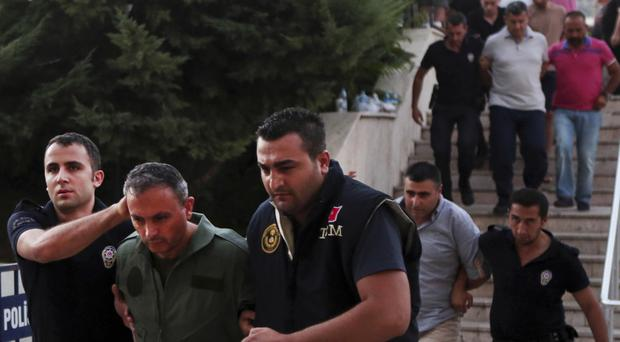 Members of Turkey's armed forces suspected of involvement in the attempted coup arrive at the court in Mugla (Depo Photos/AP)