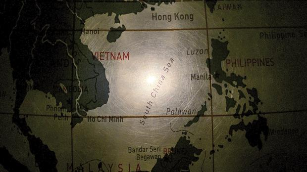 An illuminated globe shows the South China Sea (AP)