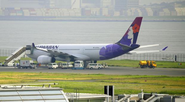A Hawaiian Airlines jet on the runway at Haneda Airport, Tokyo (AP)