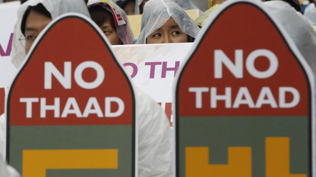 South Koreans attend a rally to oppose a deployment of the Terminal High-Altitude Area Defence, or THAAD, in Seoul (AP)