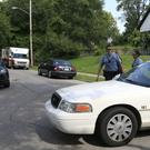 Police at the scene where an officer was shot dead in Kansas City (AP)