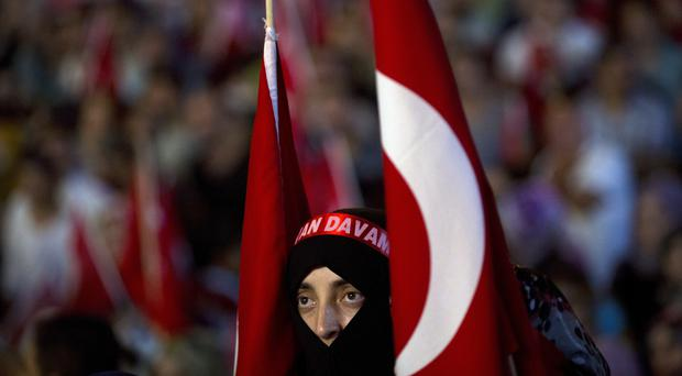 A pro-government rally in Taksim Square, Istanbul (AP)