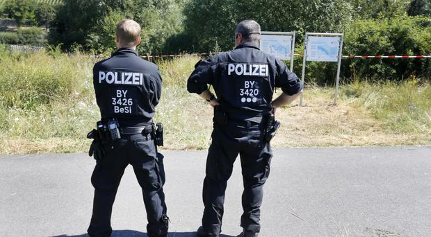 German police at the scene in Wuerzburg where the 17-year-old attacker was shot dead (AP)