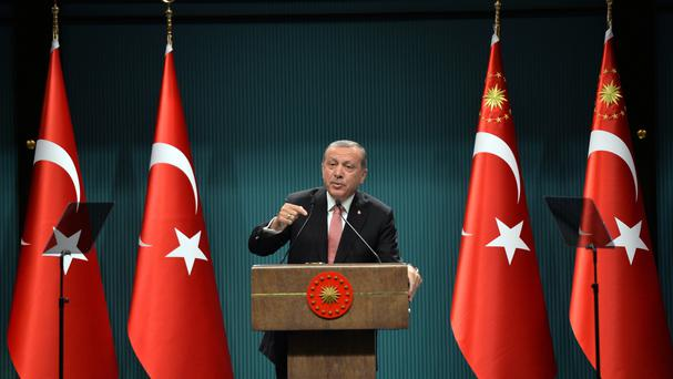 Turkey's President Recep Tayyip Erdogan declares a three-month state of emergency (AP)