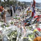 Bernard Cazeneuve has apparently backtracked on an earlier claim that national police guarded the entrance to the Promenade des Anglais in Nice (AP)