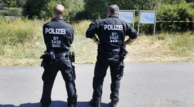 Police at the scene of the train attack in Wuerzburg, Germany (AP)