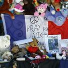 Dolls and teddy bears are placed at a memorial on the Promenade des Anglais in Nice (AP)