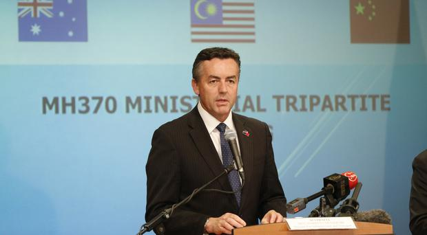 Australian Transport Minister Darren Chester speaks about the search for Malaysia Airlines Flight 370 at a joint press conference (AP)