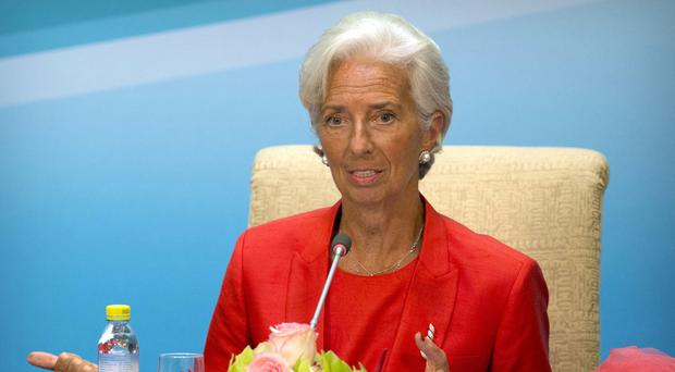 IMF chief Christine Lagarde must stand trial over a 2008 arbitration ruling (AP)