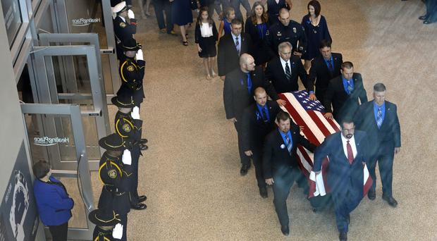 The coffin of Baton Rouge police officer Matthew Gerald is carried out of the Healing Place Church during his funeral (Bill Feig/Baton Rouge Advocate via AP)