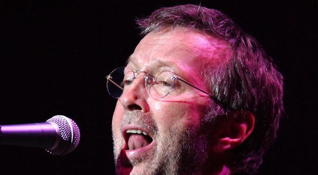 Eric Clapton auctioned the guitar to raise money for Texas musician Johnny Nicholas